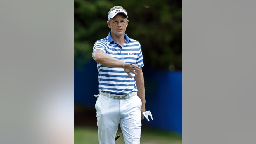 Luke Donald gestures after his putt on the first hole hole during the third round of the Wyndham Championship golf tournament in Greensboro, N.C., Saturday, Aug. 20, 2016. (AP Photo/Chuck Burton)