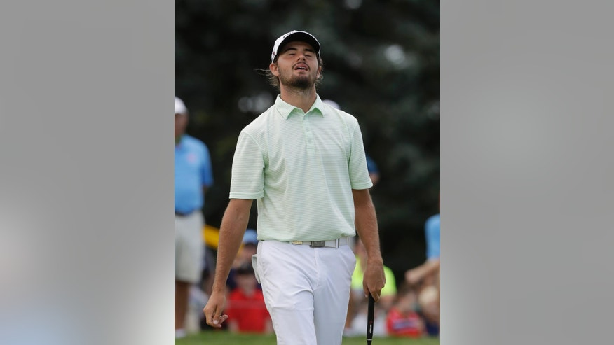 Curtis Luck, of Australia, reacts after a missed putt on the 17th green during the final round against Brad Dalke at the U.S. Amateur golf tournament at Oakland Hills Country Club, Sunday, Aug. 21, 2016, in Bloomfield Township, Mich. (AP Photo/Carlos Osorio)