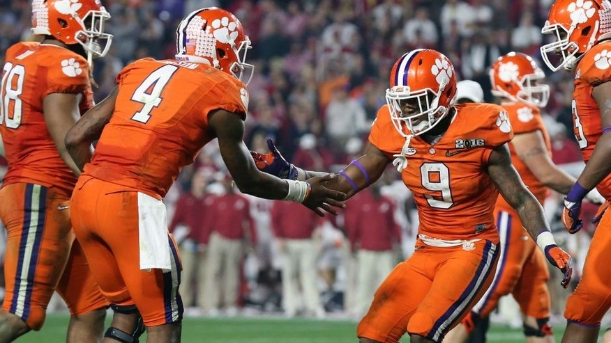 <p>Jan 11, 2016; Glendale, AZ, USA; Clemson Tigers running back Wayne Gallman (9) celebrates with Deshaun Watson (4) after scoring on a 1 yard run during the third quarter in the 2016 CFP National Championship at University of Phoenix Stadium. Mandatory Credit: Matthew Emmons-USA TODAY Sports</p>