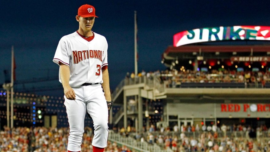 Washington Nationals starting pitcher Stephen Strasburg walks off the field in the seventh inning after 14 strikeouts in his major league debut in a baseball game against the Pittsburgh Pirates in Washington, Tuesday, June 8, 2010. (AP Photo/Manuel Balce Ceneta)