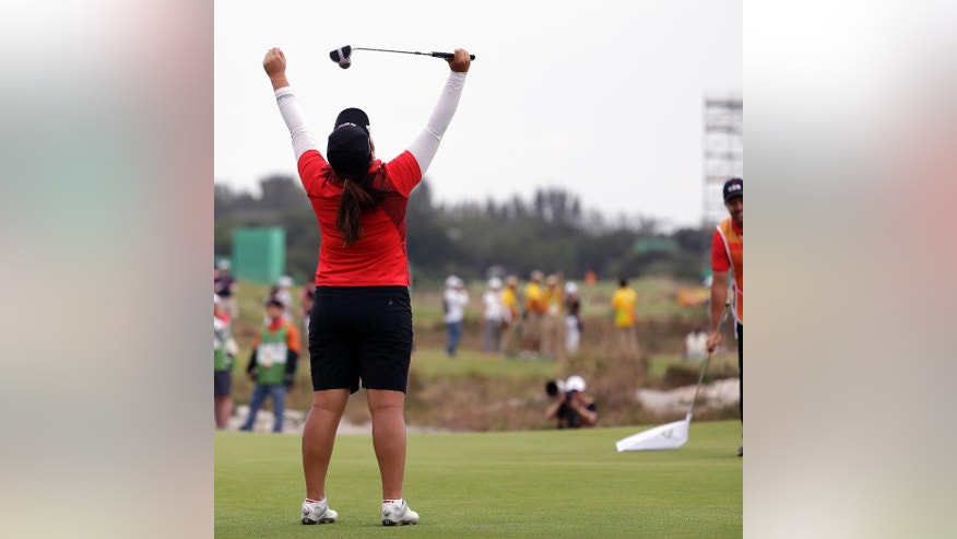 Inbee Park of South Korea, reacts after winning the gold medal on the 18th hole during the final round of the women's golf event at the 2016 Summer Olympics in Rio de Janeiro, Brazil, Saturday, Aug. 20, 2016. (AP Photo/Alastair Grant)