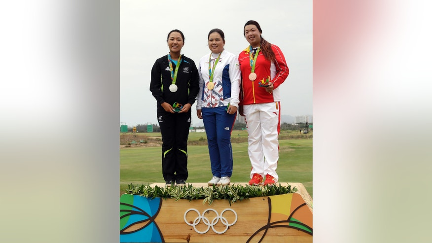 From left to right, silver medalist, Lydia Ko of New Zealand, gold medalist Inbee Park of South Korea, and bronze medalist Shanshan Feng of China, show their medals after the final round of the women's golf event at the 2016 Summer Olympics in Rio de Janeiro, Brazil, Saturday, Aug. 20, 2016. (AP Photo/Chris Carlson)