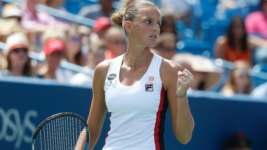 Karolina Pliskova, of the Czech Republic, reacts to winning a point against Angelique Kerber, of Germany, during the finals of the Western & Southern Open tennis tournament, Sunday, Aug. 21, 2016, in Mason, Ohio. (AP Photo/John Minchillo)