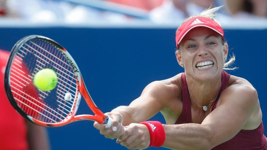 Angelique Kerber, of Germany, returns to Karolina Pliskova, of the Czech Republic, during the finals of the Western & Southern Open tennis tournament, Sunday, Aug. 21, 2016, in Mason, Ohio. (AP Photo/John Minchillo)