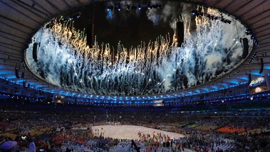 Fireworks explode during the closing ceremony for the Summer Olympics at Maracana stadium in Rio de Janeiro, Brazil, Sunday, Aug. 21, 2016.
