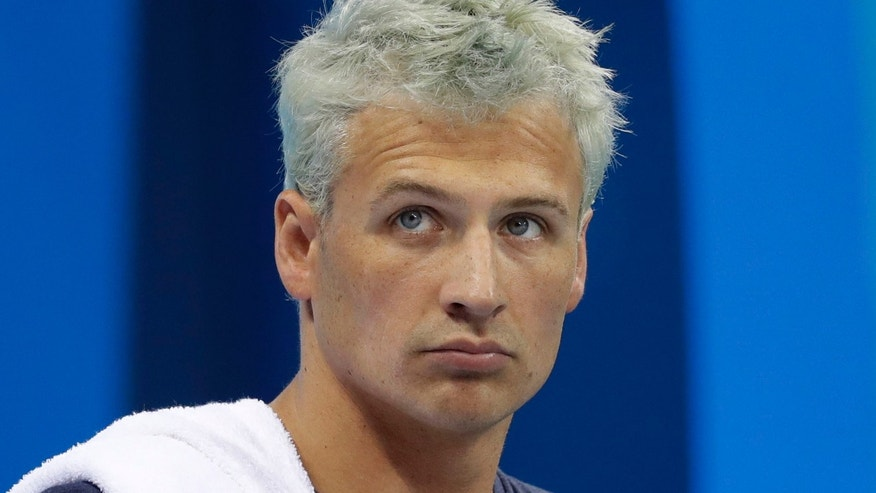 United States' Ryan Lochte prepares before a men's 4x200-meter freestyle heat during the swimming competitions at the 2016 Summer Olympics, Tuesday, Aug. 9, 2016, in Rio de Janeiro, Brazil. (AP Photo/Michael Sohn)