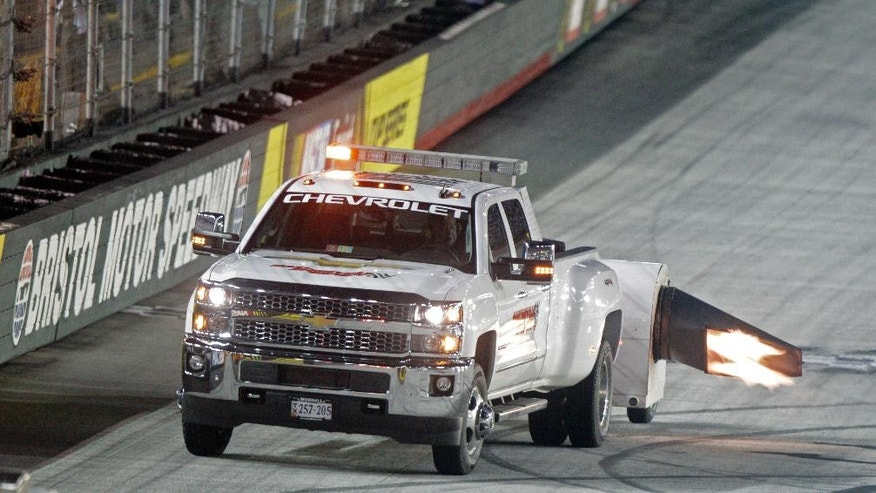 A track dryer works on an area of the track during a rain delay in the NASCAR Sprint Cup Series auto race, Saturday, Aug. 20, 2016, in Bristol, Tenn. The remainder of the race was postponed until Sunday. (AP Photo/Wade Payne)
