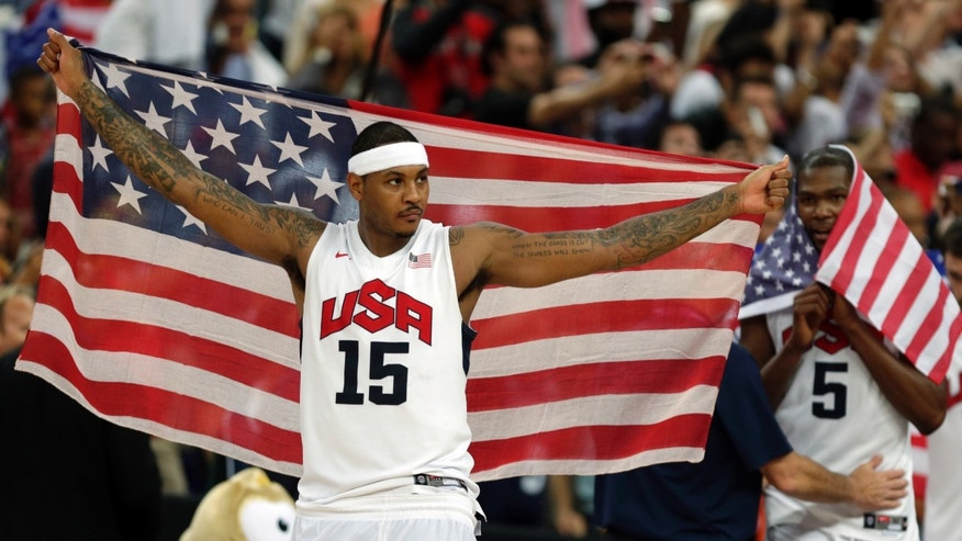 FILE - In this Aug. 12, 2012, file photo, United States' Carmelo Anthony celebrates after the men's gold medal basketball game at the 2012 Summer Olympics, in London. With two Olympic gold medals and a chance to be the first menâs player to win three, Anthony has become the unlikely face of USA Basketball, a rise that couldnât have been imagined 12 years ago. (AP Photo/Charles Krupa, File)