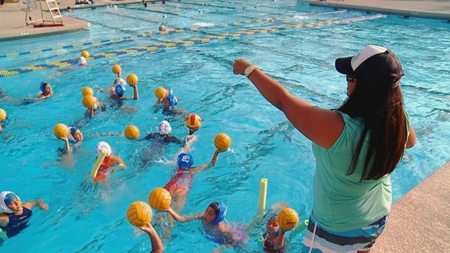 Brenda Villa instructing water polo students. (Photo: Courtesy of Brenda Villa)