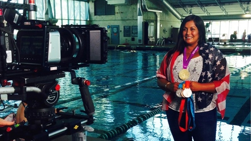 Brenda Villa posing with her Olympic water polo medals. (Photo: Courtesy of Brenda Villa)