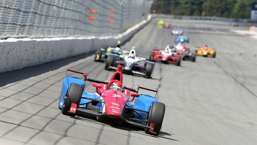 Mikhail Aleshin, of Russia, (7) drives in the Pocono IndyCar 500 auto race Monday, Aug. 22, 2016, in Long Pond, Pa. (AP Photo/Mel Evans)