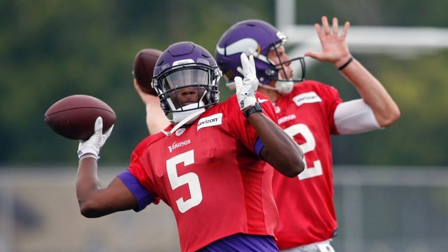 <p>Minnesota Vikings quarterbacks Teddy Bridgewater (left) and Joel Stave (right) throw passes in drills during training camp on Aug. 1 in Mankato, Minn.</p>