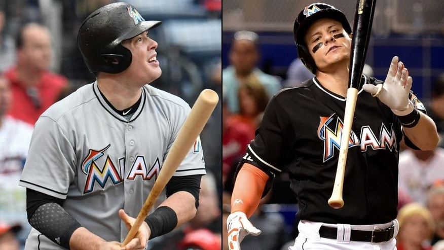 <p>Miami Marlins infielders Justin Bour (left) and Derek Dietrich (right).<br> </p>