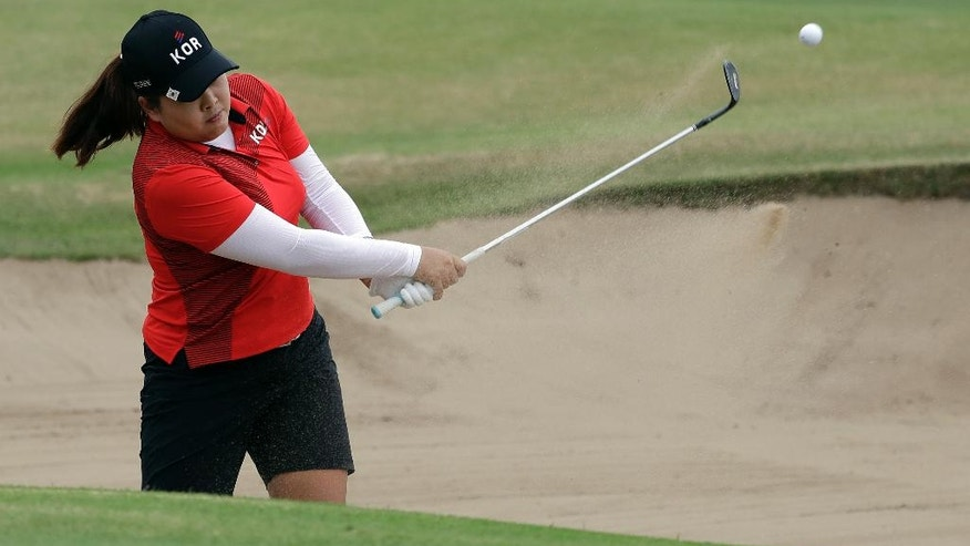 Inbee Park of South Korea, hits from a bunker on the 18th hole during the final round of the women's golf event at the 2016 Summer Olympics in Rio de Janeiro, Brazil, Saturday, Aug. 20, 2016. (AP Photo/Alastair Grant)