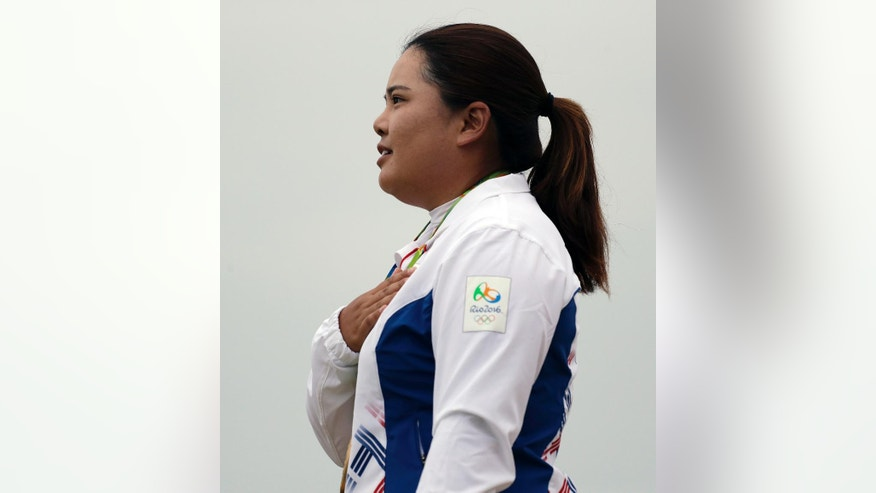 Inbee Park of South Korea, listens to her national anthem after winning the gold medal in the final round of the women's golf event at the 2016 Summer Olympics in Rio de Janeiro, Brazil, Saturday, Aug. 20, 2016. (AP Photo/Chris Carlson)