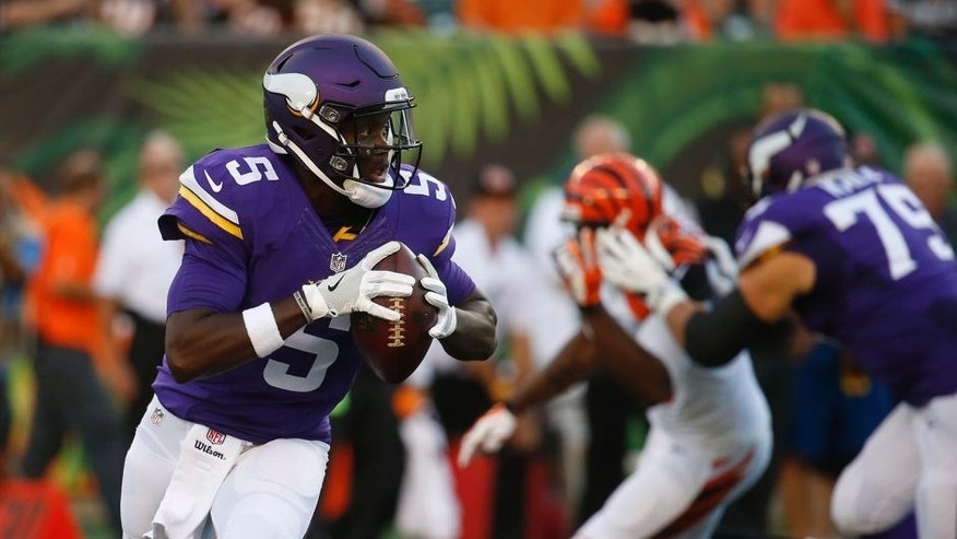Minnesota Vikings quarterback Teddy Bridgewater looks to throw during the first half of a preseason NFL football game against the Cincinnati Bengals.