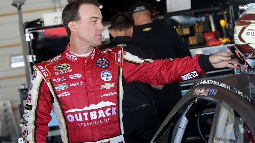 JOLIET, IL - AUGUST 23: Kevin Harvick, driver of the #4 Jimmy John's/Busch Beer Chevrolet, prepares to enter his car during testing at Chicagoland Speedway on August 23, 2016 in Joliet, Illinois. (Photo by Dylan Buell/NASCAR via Getty Images)