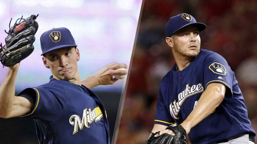 Milwaukee Brewers relief pitchers Brent Suter (left) and Corey Knebel reached a pair of major milestones in a win over the Colorado Rockies.