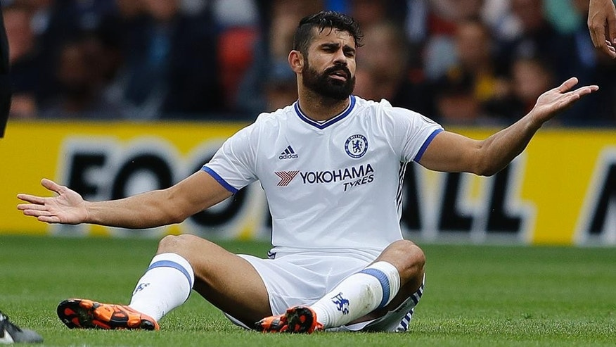Chelsea's Diego Costa gestures during the English Premier League soccer match between Watford and Chelsea at Vicarage Road stadium in London, Saturday, Aug. 20, 2016.(AP Photo/Frank Augstein)
