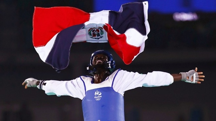 RIO DE JANEIRO, BRAZIL - AUGUST 17:  Luisito Pie of the Dominican Republic celebrates after winning bronze over Jesus Tortosa Cabrera (not pictured) in the Taekwondo Men's -58kg event during Day 12 of the Rio 2016 Olympic Games at Carioca Arena 3 on August 17, 2016 in Rio de Janeiro, Brazil.  (Photo by Ryan Pierse/Getty Images)