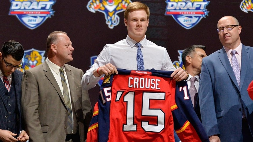 Jun 26, 2015; Sunrise, FL, USA; Lawson Crouse is presented with his team jersey after being selected as the number eleven overall pick to the Florida Panthers in the first round of the 2015 NHL Draft at BB&T Center. Mandatory Credit: Steve Mitchell-USA TODAY Sports