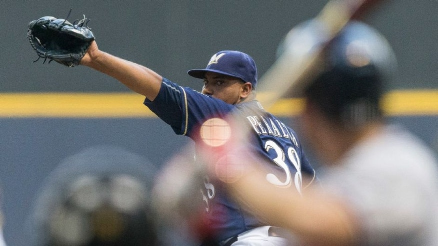 Milwaukee Brewers starting pitcher Wily Peralta throws to an Atlanta Braves' batter during the first inning on Tuesday at Miller Park.