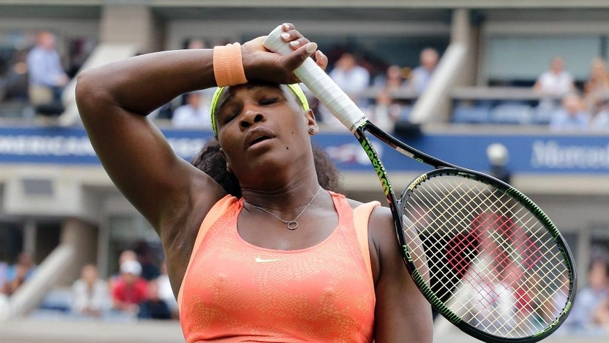 FILE - In this Sept. 11, 2015, file photo, Serena Williams reacts after losing a point to Roberta Vinci, of Italy, during a semifinal match at the U.S. Open tennis tournament, in New York. Despite everything that she has won and done, her sense of self can still fluctuate based on the outcome of a particular match. The first round of the U.S. Open tennis tournament is scheduled for Monday, Aug. 29, 2016. (AP Photo/Bill Kostroun, File)