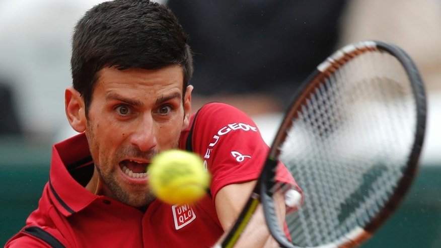 FILE - In this June 3, 2016, file photo, Serbia's Novak Djokovic returns the ball to Austria's Dominic Thiem during their semifinal match of the French Open tennis tournament at the Roland Garros stadium, in Paris. The U.S. Open tennis tournament begins Monday, Aug. 29. (AP Photo/Michel Euler, File)