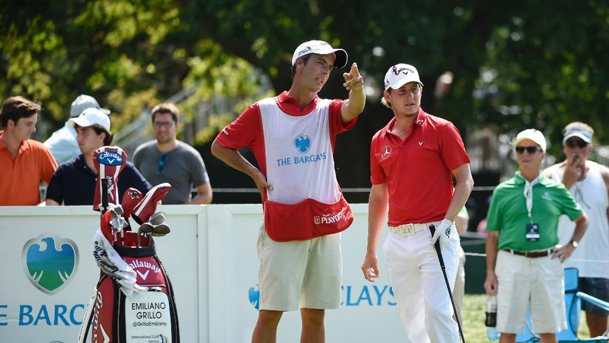 Emiliano Grillo, center right, of Argentina and his caddie Jose Campra look down the 15th fairway before Grillo tees off from the 15th hole during the second round of The Barclays golf tournament in Farmingdale, N.Y., Friday, Aug. 26, 2016, (AP Photo/Kathy Kmonicek)