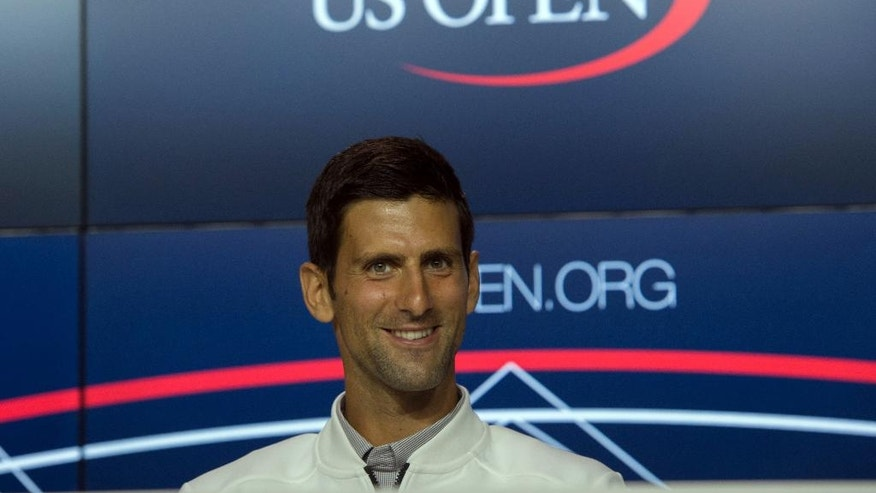 Novak Djokovic, of Serbia, speaks at a media availability for the U.S. Open at the Billie Jean King National Tennis Center, Friday, Aug. 26, 2016, in New York. (AP Photo/Bryan R. Smith)