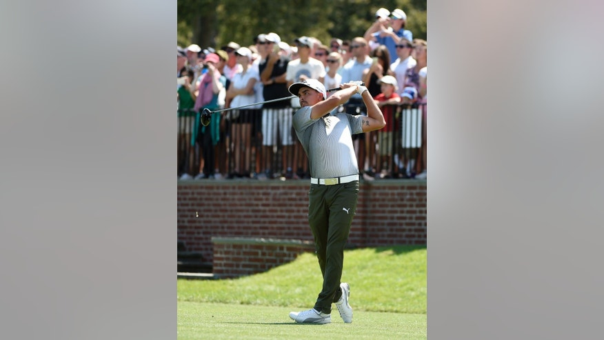 Fans watch Rickie Fowler tee off from the first hole during the third round of the Barclays golf tournament in Farmingdale, N.Y., Saturday, Aug. 27, 2016. (AP Photo/Kathy Kmonicek)