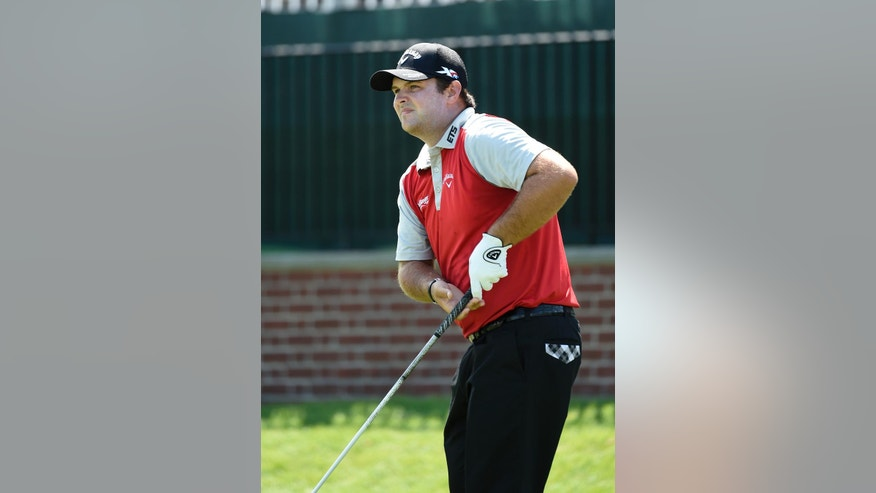 Patrick Reed watches his tee shot from the first hole during the second round of The Barclays golf tournament in Farmingdale, N.Y., Friday, Aug. 26, 2016. (AP Photo/Kathy Kmonicek)