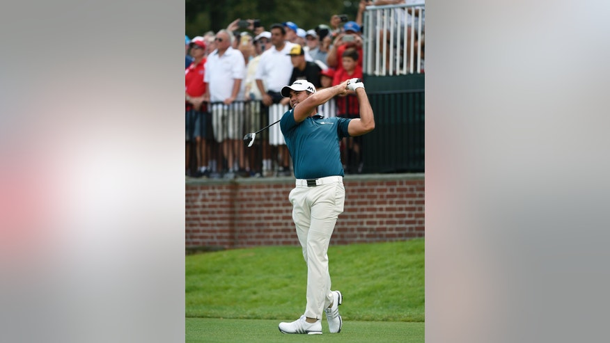 Jason Day, of Australia, the winner of the 2015 Barclays golf tournament, tees off from the first hole during the second round of The Barclays golf tournament in Farmingdale, N.Y., Friday, Aug. 26, 2016. (AP Photo/Kathy Kmonicek)