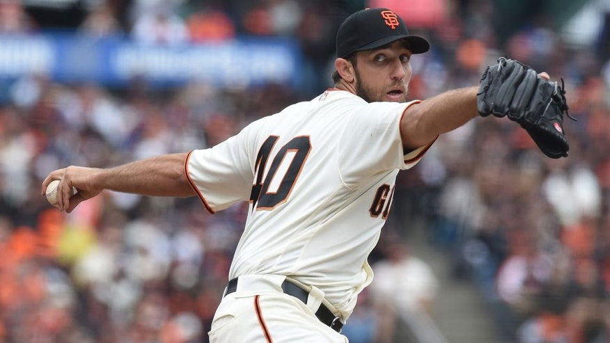Apr 9, 2016; San Francisco, CA, USA; San Francisco Giants starting pitcher Madison Bumgarner (40) throws a pitch during the first inning against the Los Angeles Dodgers at AT&T Park. Mandatory Credit: Kenny Karst-USA TODAY Sports