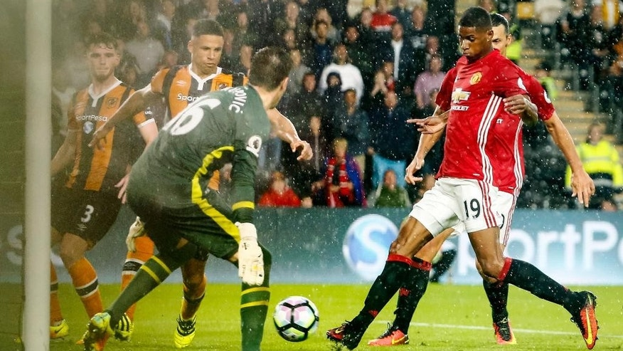 Manchester United's Marcus Rashford, right, scores the only goal of the game during the Premier League soccer match Hull City versus Manchester United at the KCOM Stadium, Hull, England, Saturday Aug, 27, 2016. (Danny Lawson/PA via AP)