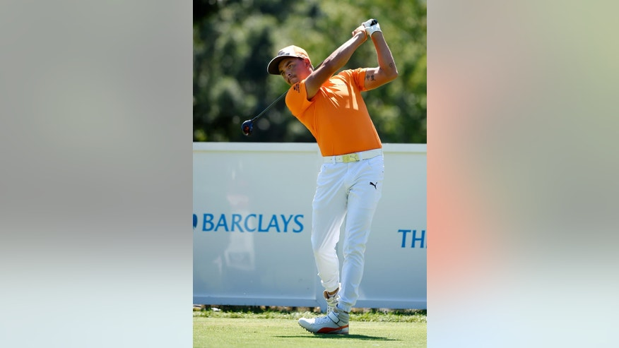 Rickie Fowler tees off from the second hole during the final round of The Barclays golf tournament in Farmingdale, N.Y., Sunday, Aug. 28, 2016. (AP Photo/Kathy Kmonicek)