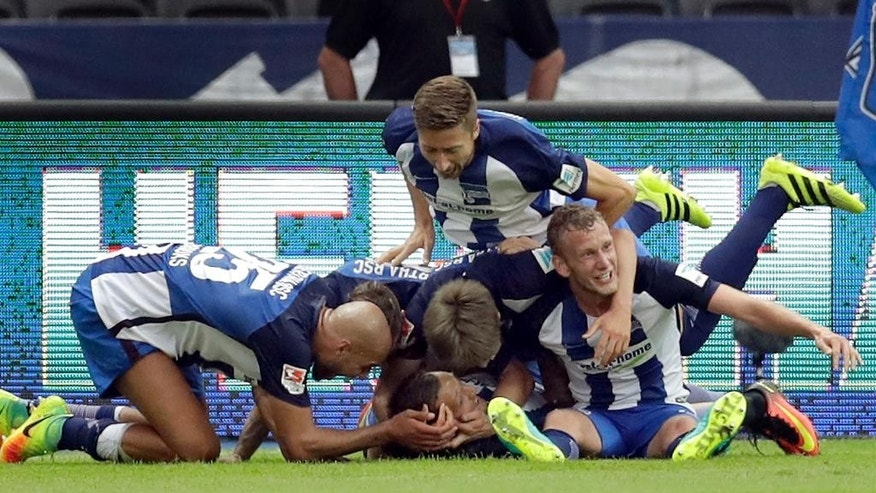 Hertha Berlin's scorer Julian Schieber, center bottom, and his teammates celebrate their side's 2nd goal during the German Bundesliga soccer match between Hertha BSC Berlin and SC Freiburg in Berlin, Germany, Sunday, Aug. 28, 2016. (AP Photo/Michael Sohn)