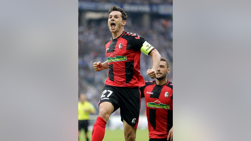 Freiburg's Nicolas Hoefler, front, celebrates after scoring his side's first goal during the German Bundesliga soccer match between Hertha BSC Berlin and SC Freiburg in Berlin, Germany, Sunday, Aug. 28, 2016. (AP Photo/Michael Sohn)