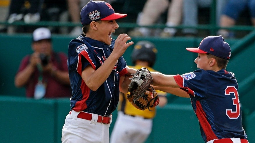 Michael Mancini, left, celebrates with Jude Abbadessa during the U.S. championship game of the Little League World Series.