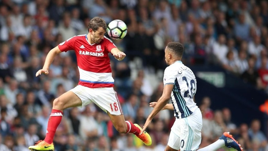 Middlesbrough's Christian Stuani, left, and West Bromwich Albion's Brendan Galloway battle for the ball during their English Premier League soccer match at The Hawthorns, West Bromwich, England, Sunday, Aug. 28, 2016. (Nick Potts/PA via AP)