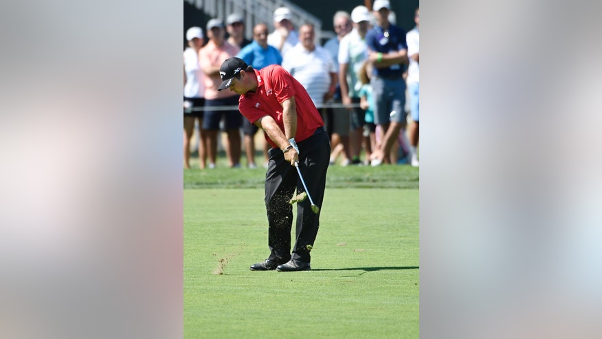 Patrick Reed hits from the fairway during the final round of The Barclays golf tournament in Farmingdale, N.Y., Sunday, Aug. 28, 2016. (AP Photo/Kathy Kmonicek)