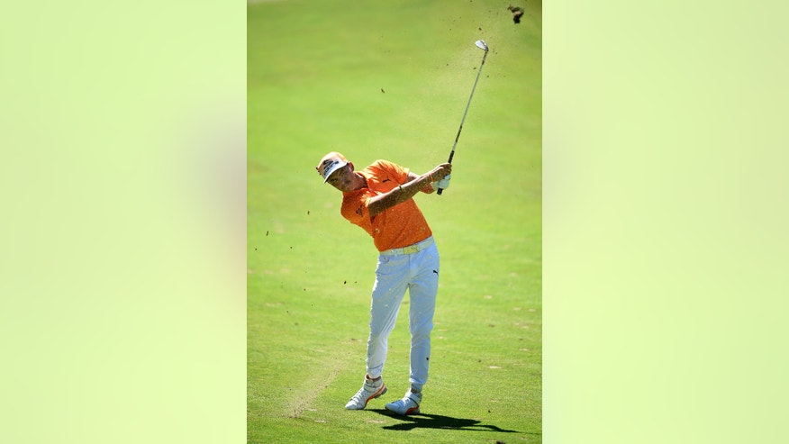 Rickie Fowler hits from the first fairway during the final round of The Barclays golf tournament in Farmingdale, N.Y., Sunday, Aug. 28, 2016. (AP Photo/Kathy Kmonicek)