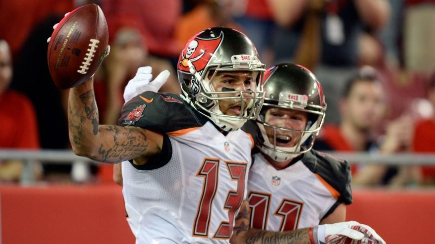 Tampa Bay Buccaneers wide receiver Mike Evans (13) celebrates with wide receiver Adam Humphries (11) after Evans caught a 34-yard touchdown pass against the Cleveland Browns during the second quarter of an NFL preseason football game Friday, Aug. 26, 2016, in Tampa, Fla. (AP Photo/Jason Behnken)