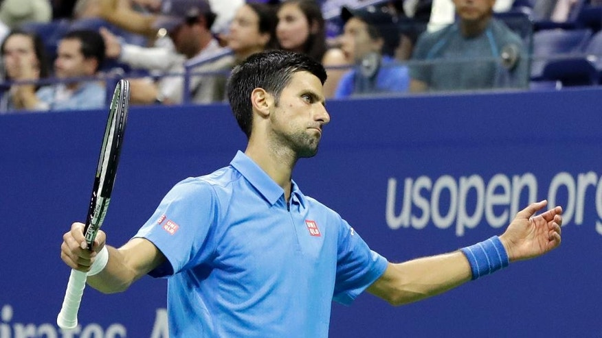 Novak Djokovic, of Serbia, reacts after missing a shot against Jerzy Janowicz, of Poland, during the first round of the US Open tennis tournament, Monday, Aug. 29, 2016, in New York. (AP Photo/Darron Cummings)