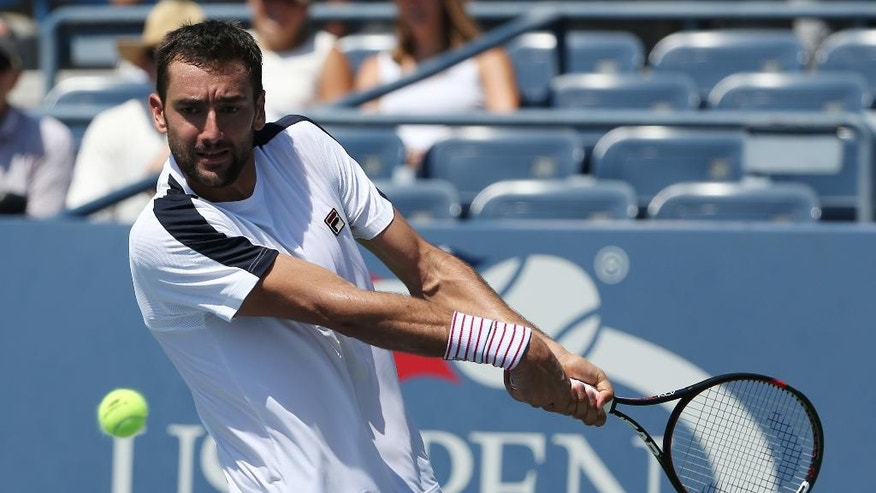 Marin Cilic, of Croatia, returns a shot to Rogerio Dutra Silva, of Brazil, during the first round of the U.S. Open tennis tournament, Monday, Aug. 29, 2016, in New York. (AP Photo/Seth Wenig)