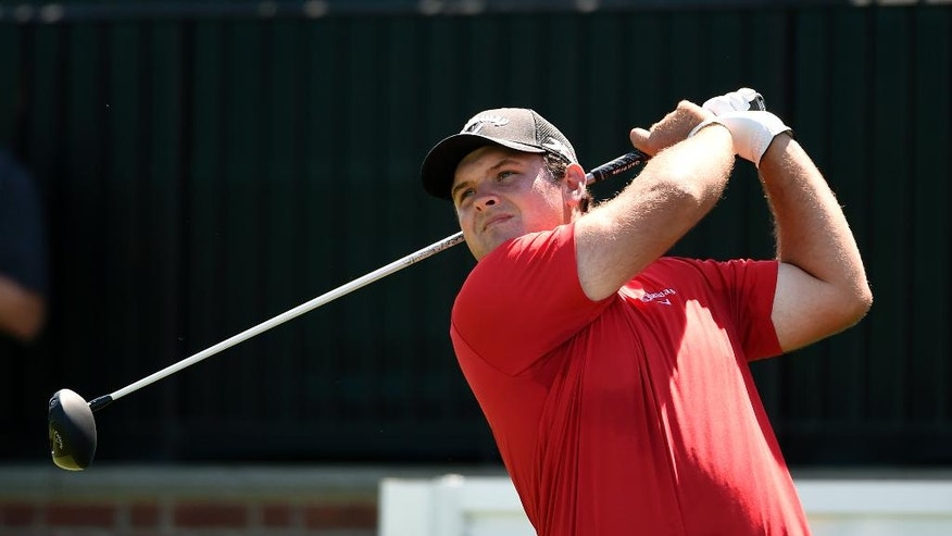 Patrick Reed tees of from the first hole during the final round of The Barclays golf tournament in Farmingdale, N.Y., Sunday, Aug. 28, 2016. Reed went on to win the tournament. (AP Photo/Kathy Kmonicek)