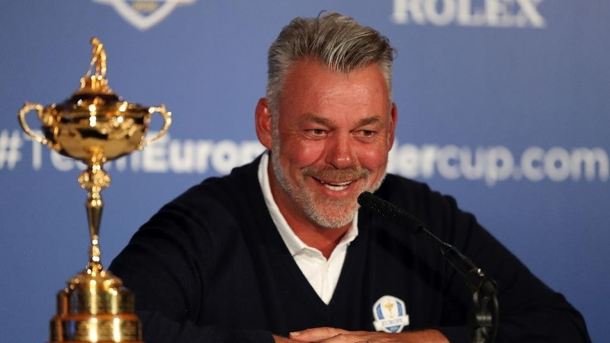 European Ryder Cup captain Darren Clarke smiles during a press conference at Wentworth Golf Club, Virginia Waters, England Tuesday Aug. 30, 2016. Lee Westwood, Martin Kaymer and Thomas Pieters will fill out the European team as Darren Clarke's captain's picks for the Ryder Cup against the United States at Hazeltine from Sept. 30-Oct. 2. Clarke announced his choices at the European Tour's headquarters at Wentworth on Tuesday. (Andrew Matthews/PA via AP)