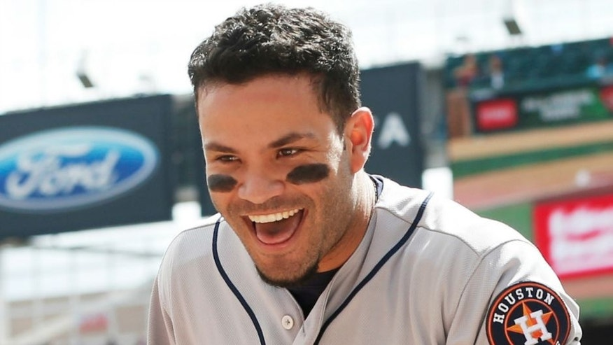 Houston Astros' Jose Altuve, celebrates after scoring from second on an error by Minnesota Twins catcher Juan Centeno in the first inning of a baseball game Thursday, Aug. 11, 2016 in Minneapolis. (AP Photo/Jim Mone)
