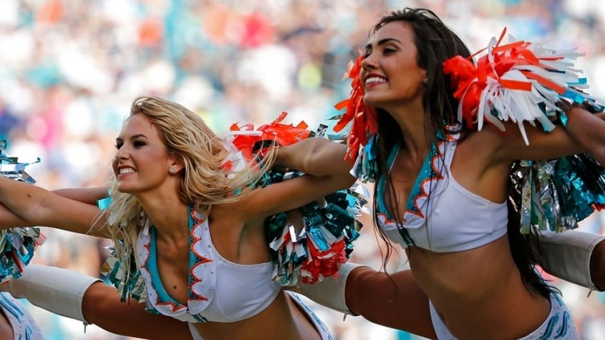 Nov 22, 2015; Miami Gardens, FL, USA; Miami Dolphins cheerleaders perform during the second half against the Dallas Cowboys at Sun Life Stadium. The Cowboys won 24-14. Mandatory Credit: Steve Mitchell-USA TODAY Sports
