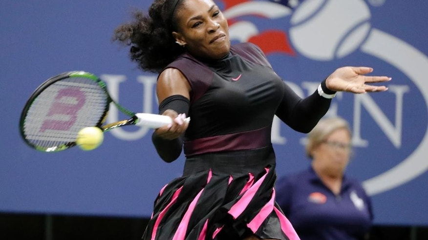 Serena Williams, of the United States, returns a shot from Ekaterina Makarova, of Russia, during the first round of the U.S. Open tennis tournament, Tuesday, Aug. 30, 2016, in New York. (AP Photo/Darron Cummings)